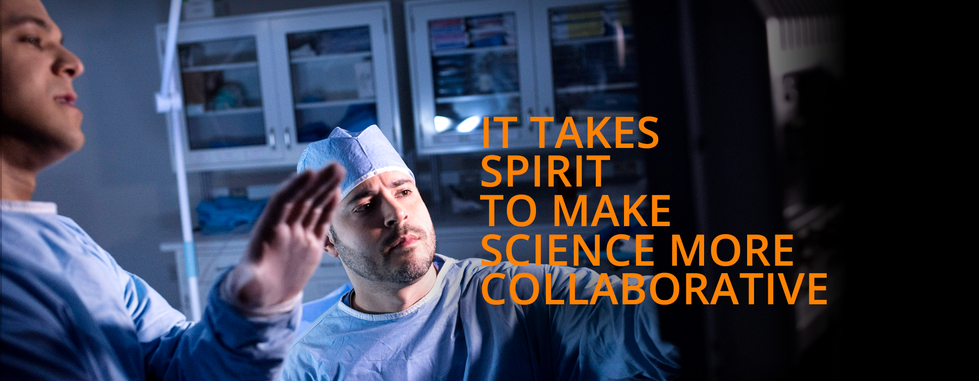 "Background image with doctors looking at screen. Animated text ""It takes imagination to make science more transformative. It takes spirit to make science more collaborative. It takes grit to make science more purposeful."""