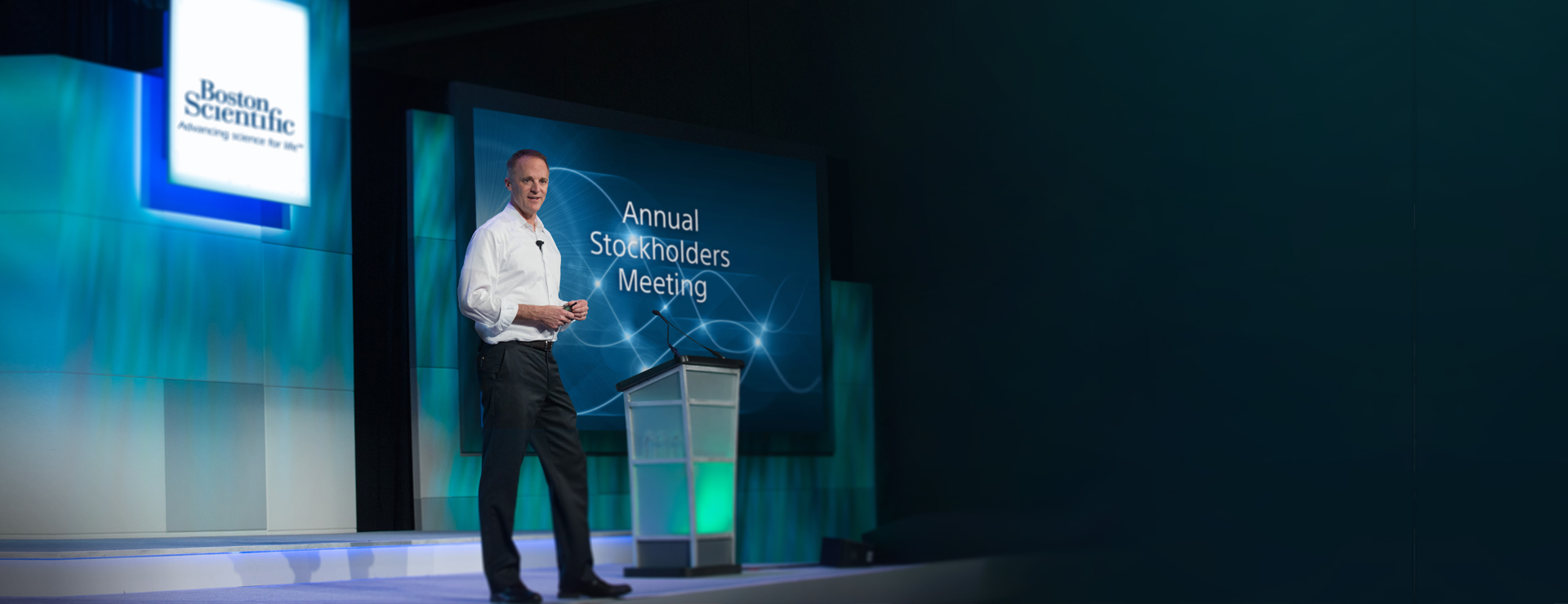 Michael Mahoney on stage at the Annual Stockholders Meeting.
