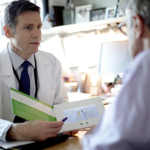 physician speaking with patient about greenlight laser therapy
