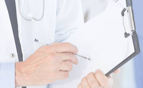 Physician hands with clipboard.