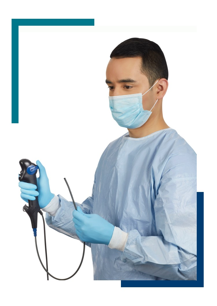 Man in hospital gown holding regular size Model B scope
