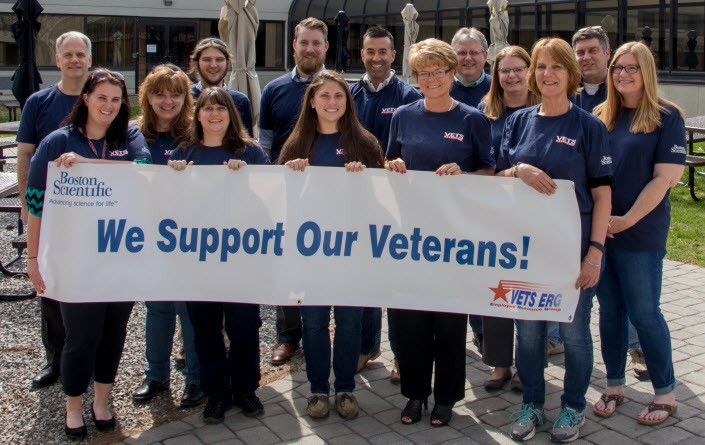 Employee with veterans support banner