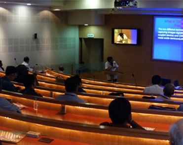 Lecture hall, during lecture, from the view of the audience.