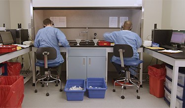 Two pathologists working in a lab