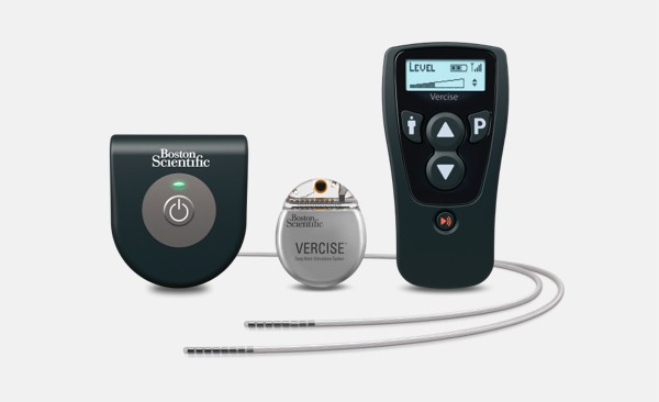 Vercise DBS System components, including wireless charging system, IPG, remote and leads.