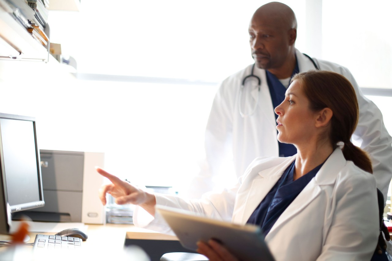 Two physicians looking at computer