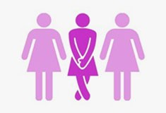 Three women, one clenching having to use the restroom