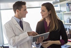 Physician consulting with a patient over an iPad
