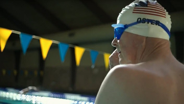 Background image of a swimmer getting ready to go in pool