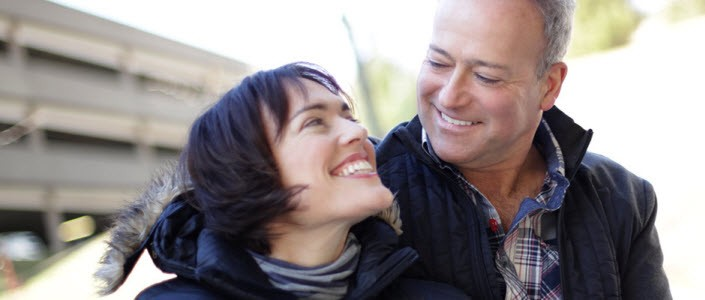 Image of man and woman smiling