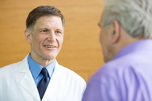 Physician meeting patient