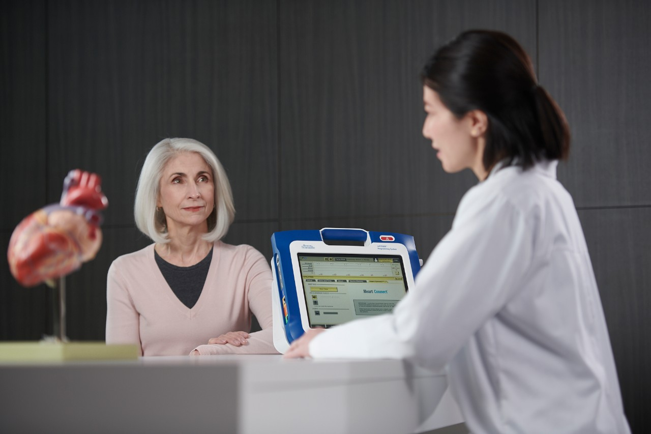 Patient and clinician sharing programmer screen information with a remote user via the Heart Connect System.