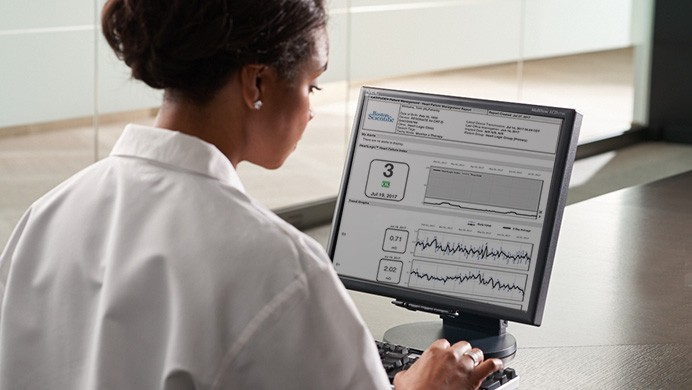Physician Looking at a Patient Report on the LATITUDE NXT Website