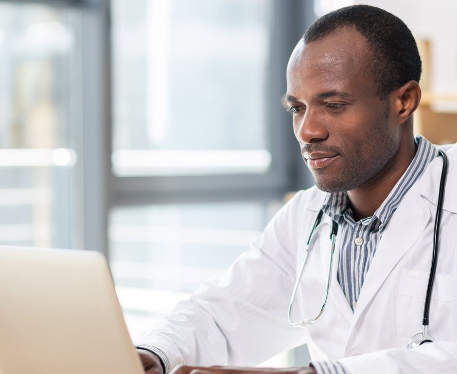 A clinician uses a laptop